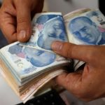 Turkish lira sinks to new historic low as US sanctions against Iran cause further fears